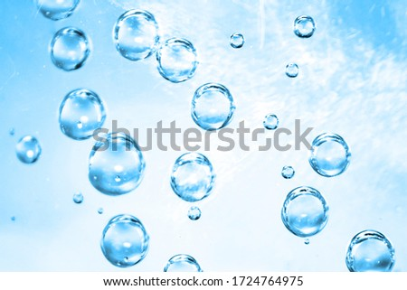 Air bubbles in blue water background, bright natural water texture #1724764975
