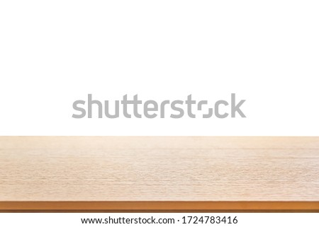Wood table top isolated on white background. Brown wooden desk empty counter. Copy space for text and ideal for product placement. Royalty-Free Stock Photo #1724783416