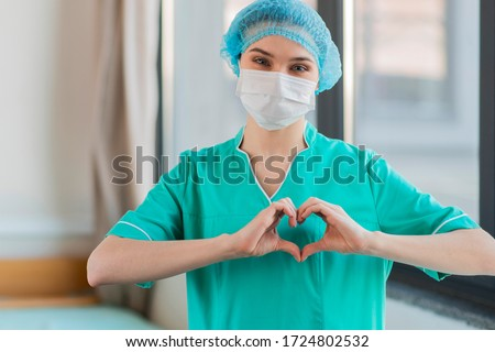 Nurse with hands heart shape