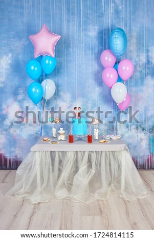 Children's funny birthday party in decorated room with balloons. Happy celebration of International Children's Day at home. Vertical photo, copy space