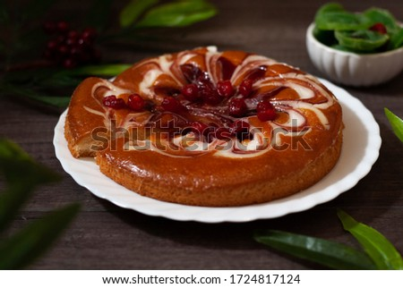Tasty homemade cherry pie on the table. Beautiful food picture. Close up compositon on dark brown gray wooden background