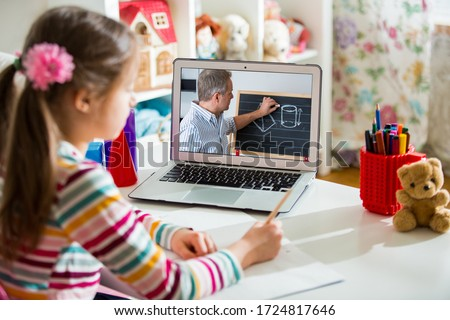 Middle-aged distance teacher having video conference call with pupil using webcam. Online education and e-learning concept. Home quarantine distance learning and working from home. #1724817646