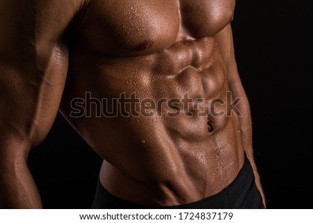 Muscled male torso with abs Royalty-Free Stock Photo #1724837179