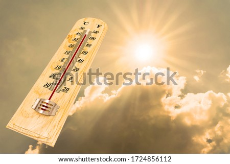 The thermometer showing high temperatures over 40 degree with sunlight background.