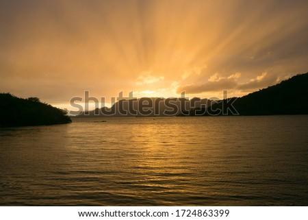 The sun rises over Coron island mountains and sea #1724863399