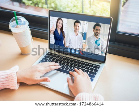 Woman video conference with team on laptop,have online briefing or consultation from home,Business team using laptop for speak talk on group in video call. Group of people working from home. #1724866414