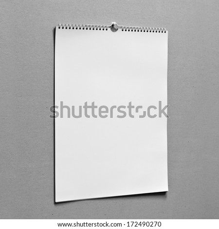 Photo. Blank wall calendar with spring on a texture background. Side view