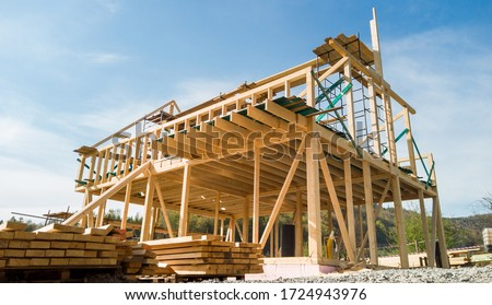 Framing of a new wooden house under construction Royalty-Free Stock Photo #1724943976