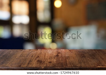 Empty dark wooden table in front of abstract blurred bokeh background of restaurant . can be used for display or montage your products.Mock up for space. Royalty-Free Stock Photo #1724967610