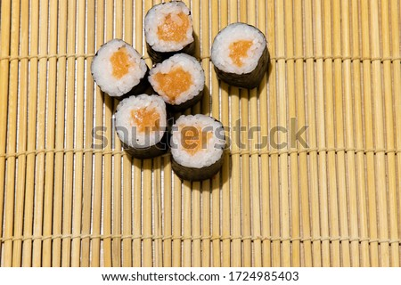 Asian cuisine sushi rolls maki with salmon raw fish home made food photography objects on wooden carpet background on table concept picture