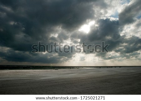 The cloudy dark sky before the sunset over Sarasota town beach (Florida).