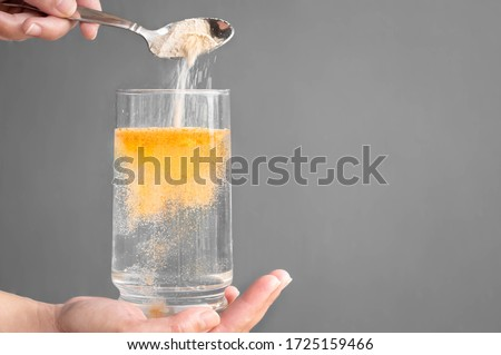 Orange fizzy powder and water glass with copy space. Healthy supplement.  #1725159466