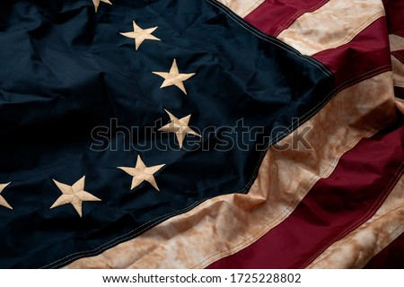 Revolutionary war, patriotism and birth of the United Sates of America concept with closeup on the original 13 star American flag known as the Betsy Ross Royalty-Free Stock Photo #1725228802