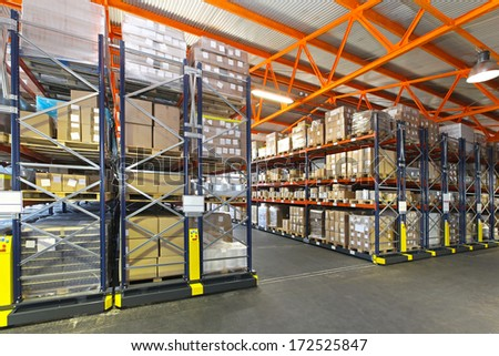Mobile roller shelving system in distribution warehouse #172525847