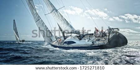 Sailing yachts team at the regatta Royalty-Free Stock Photo #1725271810
