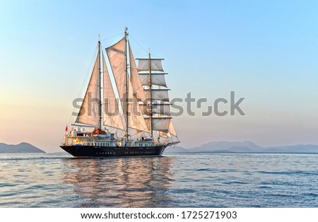 Luxury sailing yacht at sunset in the sea Royalty-Free Stock Photo #1725271903