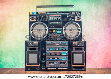 Retro boombox ghetto blaster outdated portable radio receivers with cassette recorder from 80s front gradient colored wall background. Rap, Hip Hop, R&B music concept. Vintage old style filtered photo #1725272896