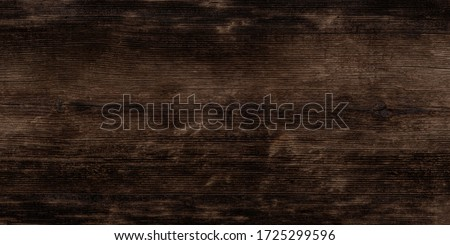 Texture of black and dark brown old wood. Charred and burnt old Board with knots. Wide burned board texture close-up, panoramic banner. #1725299596