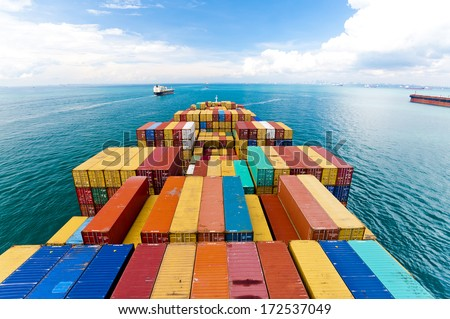 Cargo ships entering one of the busiest ports in the world, Singapore. Royalty-Free Stock Photo #172537049