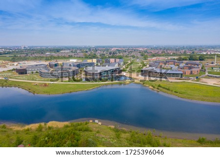 Aerial photo of the University of York, Campus East buildings in the City of York in North Yorkshire in the UK along side a lake on a sunny summers day taken with a drone