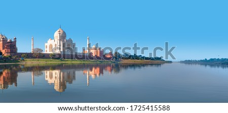 Taj Mahal mausoleum reflected in Yamuna river - Agra, Uttar Pradesh, India Royalty-Free Stock Photo #1725415588