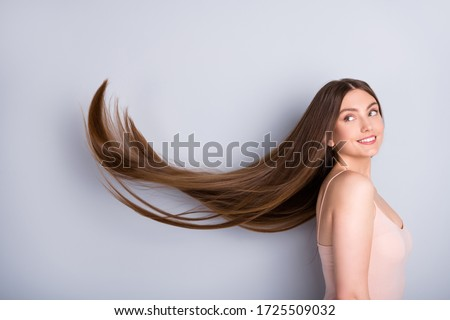 Profile photo of attractive model lady look demonstrate ideal neat long healthy hairstyle flying on air after lamination procedure wear beige singlet isolated grey color background Royalty-Free Stock Photo #1725509032
