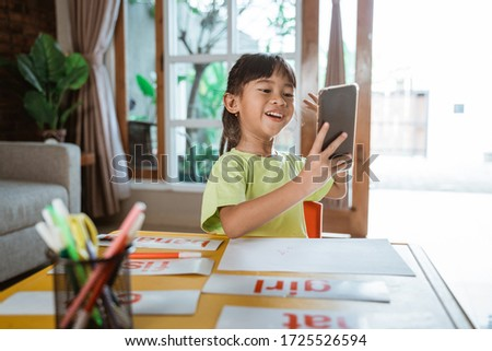 home learning with mobile phone. kid homeschooling studying online #1725526594