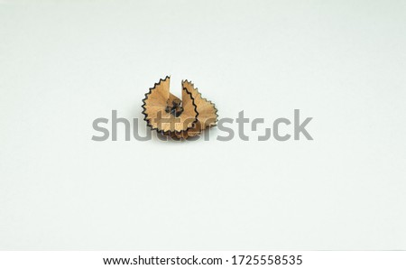 pencil cuttings, scraper isolated in white background, pencil sharpening, creative images