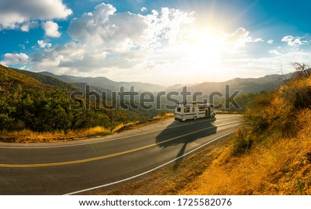 Epic nature mountain view with a road side parked RV motorhome. Travelling lifestyle roadtrip adventure in the USA Royalty-Free Stock Photo #1725582076