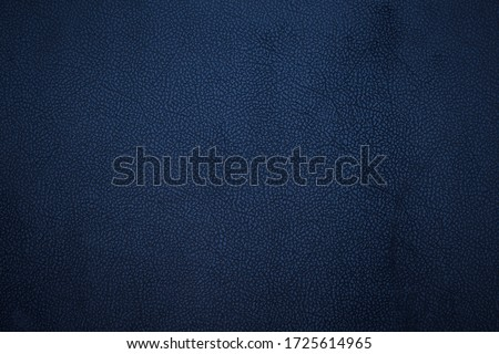 Old dark blue faux leather. Background. Texture.