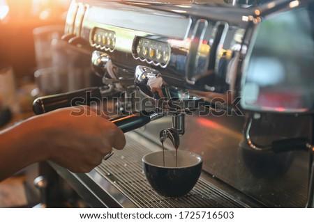 coffee machine,Coffee machine in steam, barista preparing coffee at cafe #1725716503