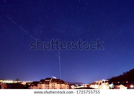 Starlink stellites in the  night sky.