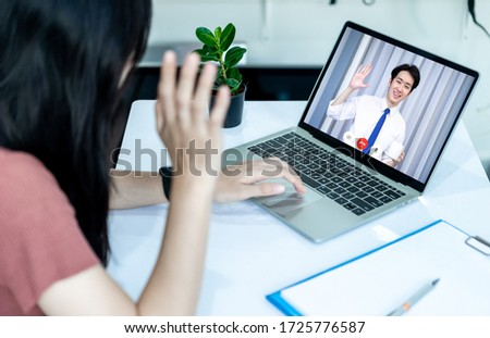 Asian woman using laptop, smartphone and tablet to work from home and video call online via internet with customer from home. Cozy office workplace. Work from home or E-Learning concept. #1725776587