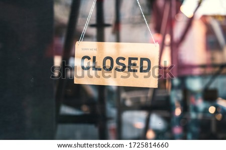 """A sign that says """"Sorry, we're closed"""". Shops in Munich and throughout Germany and Europe close due to financial difficulties and economic crisis. Royalty-Free Stock Photo #1725814660"""