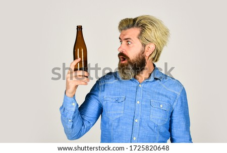 Having alcohol addiction and bad habits. Having fun. Alcoholism problem. Man with tousled hair looks unhealthy. Hangover syndrome. Drunk man. Alcoholic guy. Refreshing alcoholic drink. Alcohol addict. #1725820648