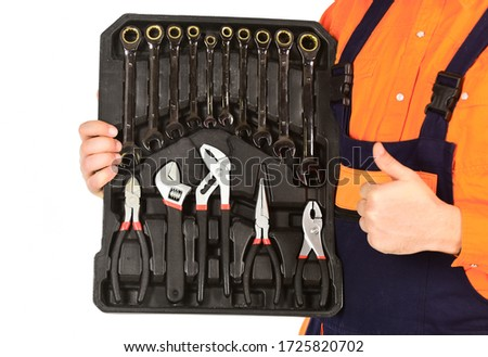 Really good tools. Handyman concept. Professional equipment. Toolbox talk. Mechanic Tool Box. Man in uniform carries toolbox white background. Worker repairer repairman handyman carrying toolbox. #1725820702