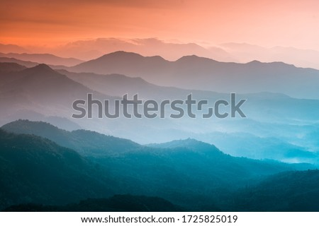 Mountains under mist in the morning Amazing nature scenery  form Kerala God's own Country Tourism and travel concept image, Fresh and relax type nature image #1725825019