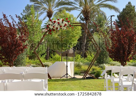 Outdoor wedding ceremony venue decor. Equipment rental concept.
