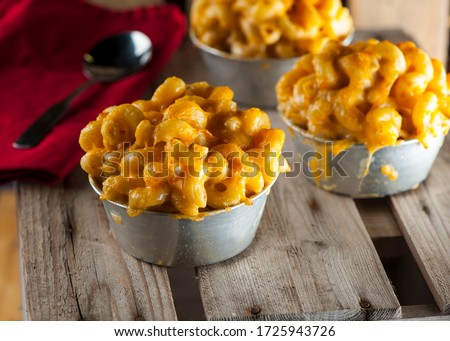 Mac N cheese. Classic American bar appetizer, loaded Mac n cheese. Macaroni mixed with melted cheddar cheese, grilled Cajun shrimp, crispy bacon, jalapeños, spicy corn salsa, and cilantro. #1725943726