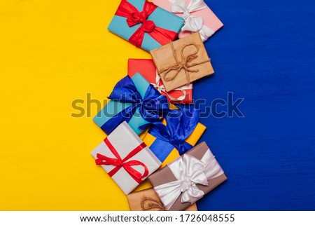 Multi-colored gifts on the birthday party background for inscriptions