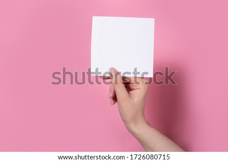 photo frames on a pink background in the hands of a girl
