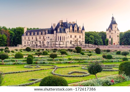 Chateau de Chenonceau in summer, France. This old castle located near the village of Chenonceaux is a landmark of Loire Valley. Scenic view of the Chenonceau palace with a beautiful garden at sunset. #172617386