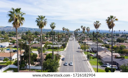 Daytime aerial view of the urban center of West Covina, California.