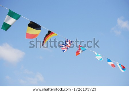 Flags of the world stretched across the sky