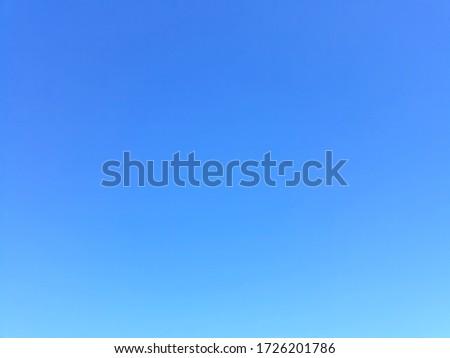 Plain light blue sky without clouds