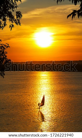 Sunset lake view windsurfing. Windsurfing sunset #1726221940