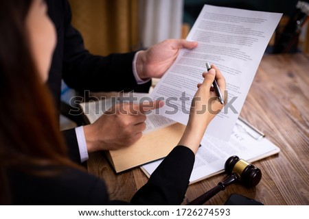 Mediation client meeting lawyer consulting government help, Businessman and Male lawyer or judge consult having team meeting with client, Law and Legal services concept. Royalty-Free Stock Photo #1726274593