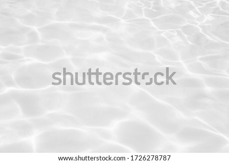 Closeup of desaturated transparent clear calm water surface texture with splashes and bubbles. Trendy abstract nature background.  #1726278787