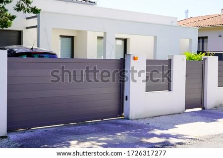 street suburb home grey brown dark metal aluminum house gate slats garden access door Royalty-Free Stock Photo #1726317277