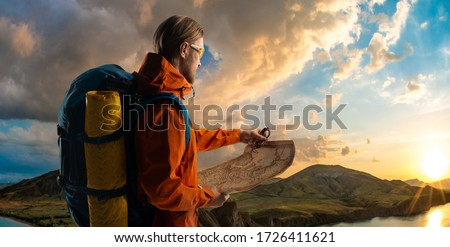 tourist - backpacker with backpack, touristic equipment, map and compass on beauty nature mountain landscape Crimea background, horizontal photo, travel and vacation concept #1726411621